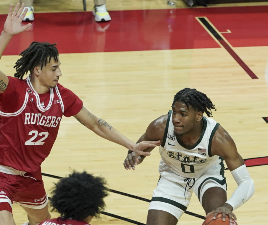 Aaron Henry tries a create his own shot while being hounded by Rutgers guard Caleb McConnell/ Photo Credit: Rutgers Athletics