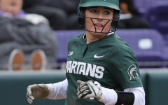 MSU shortstop Caitie Ladd smiles after scoring a run/ Photo Credit: MSU Athletic Communications