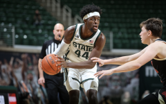 Gabe Brown looks for an open teammate against Nebraska/ Photo Credit: MSU Athletic Communications