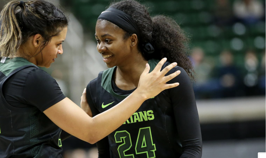 Mo Joiner smiles alongside Nia Clouden (24)/ Photo Credit: MSU Athletic Communications