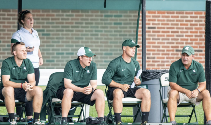 MSU+head+coach+Damon+Rensing+%28far+right%29+sits+next+to+his+coaching+staff%2F+Photo+Credit%3A+MSU+Athletic+Communications%0A%0A