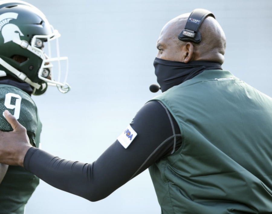 MSU head coach Mel Tucker talks with safety Dominique Long during a game/ Photo Credit: MSU Athletic Communications