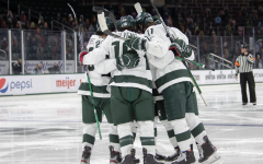 The MSU hockey team huddles together before a game/ Photo Credit: MSU Athletic Communications