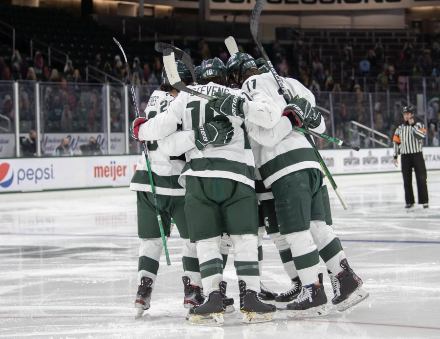 The+MSU+hockey+team+huddles+together+before+a+game%2F+Photo+Credit%3A+MSU+Athletic+Communications%0A%0A