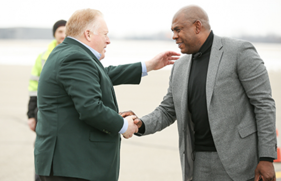 MSU athletic director Bill Beekman shakes the hand of new football head coach Mel Tucker/ Photo Credit: MSU Athletic Communications