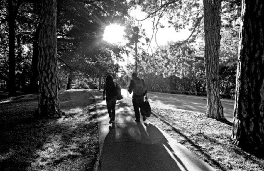 Two students walking together/ Photo Credit: MSU University Communications