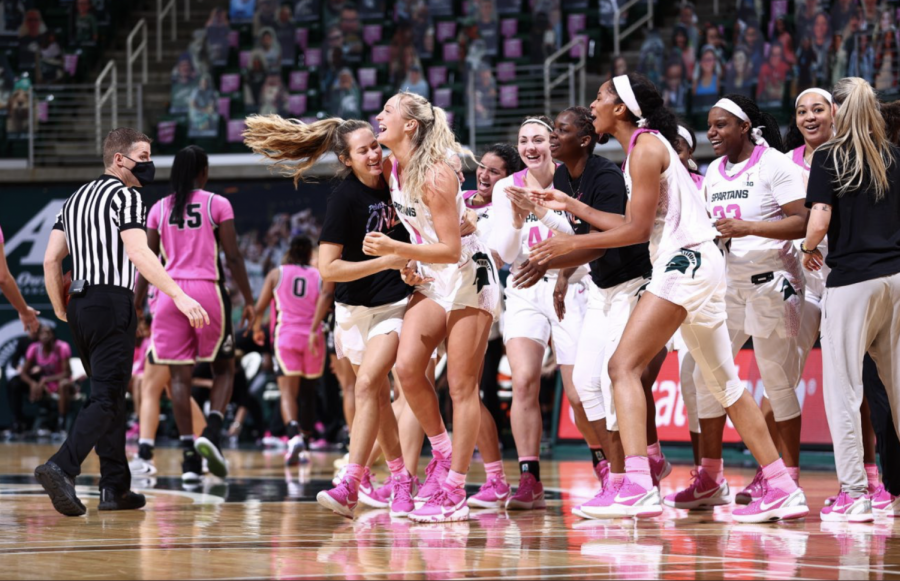Tory Ozment gets mobbed after draining a 3-pointer at the buzzer to give the Spartans' a 76-73 home win over Purdue/Photo Credit: MSU Athletic Communications