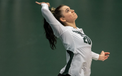 MSU outside hitter Cecile Max-Brown serves against No. 1 Wisconsin/ Photo Credit: MSU Athletic Communications