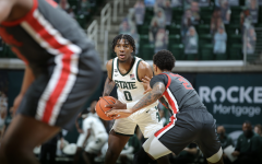 MSU forward Aaron Henry looks for an open teammate against No. 5 Ohio State/ Photo Credit: MSU Athletic Communications