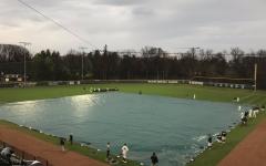 The field at McLane Baseball Stadium covered with a tarp/ Photo Credit: Luke Sloan/WDBM
