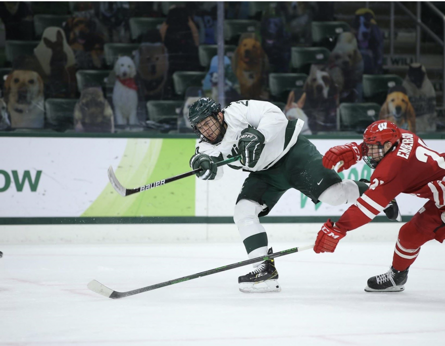 MSU defenseman Dennis Cesana shoots a puck in the Spartans' 4-0 loss to No. 5 Wisconsin /Photo Credit: MSU Athletic Communications