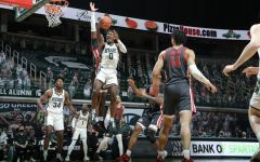 Aaron Henry skies for a layup in the Spartans' 71-67 win over No. 4 Ohio State/ Photo Credit: MSU Athletic Communications