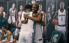 Joshua Langford hugs Aaron Henry after the Spartans' knock off No. 2 Michigan 70-64/ Photo Credit: MSU Athletic Communications
