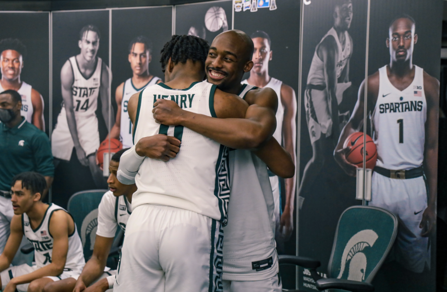 Joshua+Langford+hugs+Aaron+Henry+after+the+Spartans%27+knock+off+No.+2+Michigan+70-64%2F+Photo+Credit%3A+MSU+Athletic+Communications%0A%0A