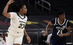 MSU guard Janai Crooms celebrates after nailing a 3-pointer in the Spartans' 75-66 win over Penn State in the first round of the 2021 Big Ten Tournament/ Photo Credit: MSU Athletic Communications