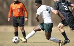 MSU forward Farai Mutatu dribbles the ball during a game/ Photo Credit: MSU Athletic Communications