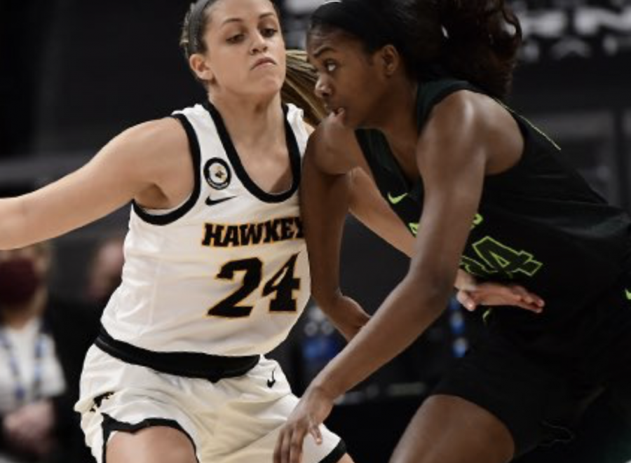 Nia Clouden drives against Iowa guard Gabbie Marshall/ Photo Credit: MSU Athletic Communications