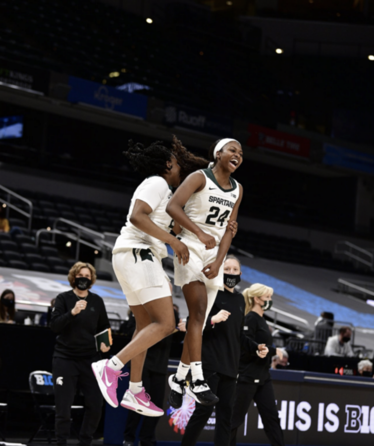 Nia Clouden and Janai Crooms celebrate after MSU knocks off Penn State 75-66 in the first round of the 2021 Big Ten tournament/ Photo Credit: MSU Athletic Communications