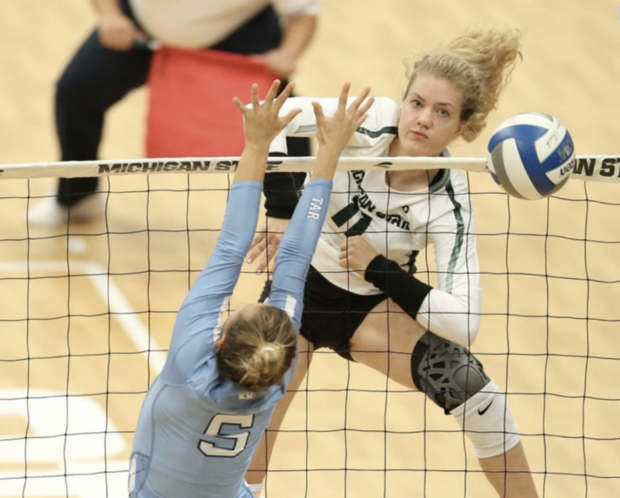 MSU outside hitter Alyssa Chronowski rises to block an opponents serve/ Photo Credit: MSU Athletic Communications