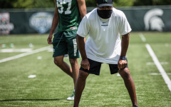 MSU wide receivers coach Courtney Hawkins supervises a group of wide receivers during fall practice of 2020/ Photo Credit: MSU Athletic Communications