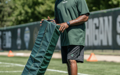 MSU wide receiver Courtney Hawkins holds a bag during football practice/ Photo Credit: MSU Athletic Communications
