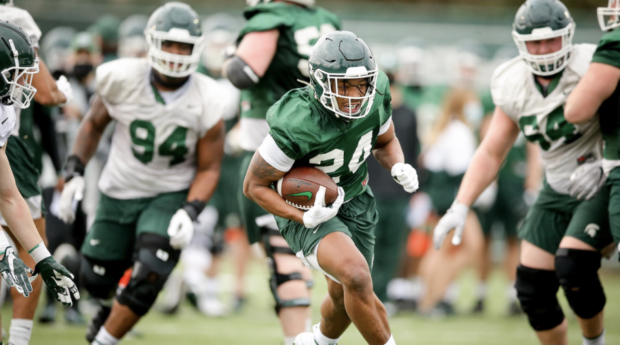 MSU running back Elijah Collins runs through a hole during spring practice/ Photo Credit: MSU Athletic Communications