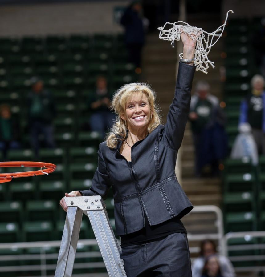 MSU head coach Suzy Merchant cuts down the nets after winning the 2014 Big Ten regular season title/Photo Credit: MSU Athletic Communications