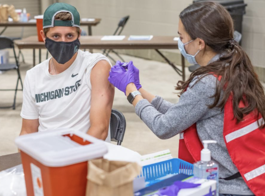 An+MSU+student+gets+vaccinated+at+the+MSU+student+clinic%2F+Photo+Credit%3A+MSU+University+Communications+%0A