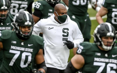 MSU head coach Mel Tucker runs out of the tunnel with his team before a game/ Photo Credit: MSU Athletic Communications