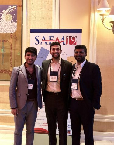 Danyoul Yamin, Tejeshwar Bawa, and Sukhwindar Ajimal presenting their resesrch at SAEM