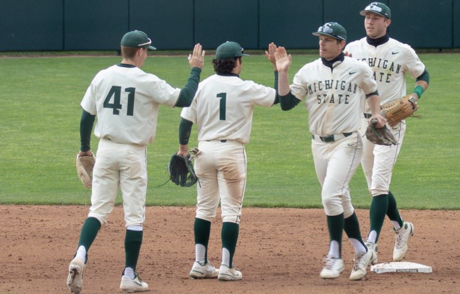 MSU infielders Trent Farquhar (1) and Mitch Jebb (41) celebrate after knocking off Rutgers/ Photo Credit: MSU Athletic Communications