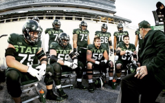 MSU offensive line coach Chris Kapilovic talks with right tackle Kevin Jarvis (75), right guard Matt Carrick (56), center Nick Samac (59), left guard JD Duplain and others against No. 8 Northwestern/ Photo Credit: MSU Athletic Communications