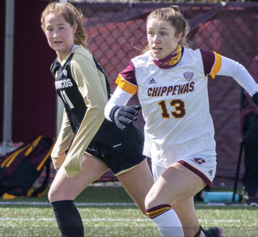 New+MSU+forward+Lauren+DeBeau+runs+past+a+Western+Michigan+player+during+a+game%2F+Photo+Credit%3A+Central+Michigan+Athletic+Communications