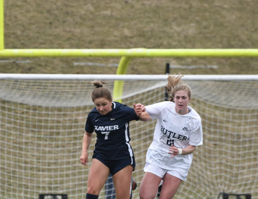 MSU forward Justina Gaynor (21) vies for possession against Xavier midfielder Maddie Thiss (7) on March 14, 2020/ Photo Credit: Butler Athletic Communications