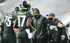 MSU head coach Mel Tucker high-fives wide receiver Tre Mosley (17) and offensive lineman Kevin Jarvis (75)/ Photo Credit: MSU Athletic Communications