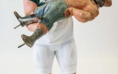 MSU defensive tackle Alex VanSumeren holds the Paul Bunyan Trophy during his visit to East Lansing on June 4/ Photo Credit: MSU Athletic Communications