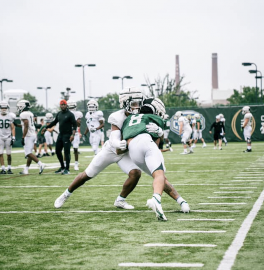 MSU wide receiver Jalen Nailor runs over a defender during fall practice/ Photo Credit: MSU Athletic Communications