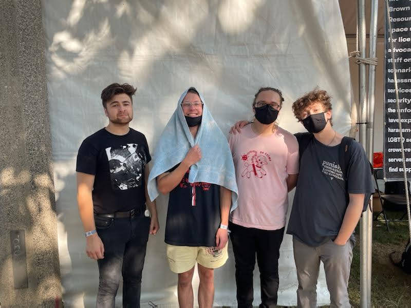 Dogleg poses beside a tent at the 2021 Pitchfork Music Festival