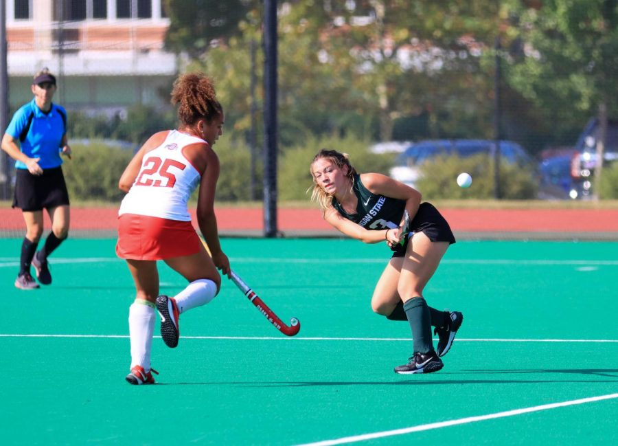 Midfielder Maddie McDonough takes a shot as an Ohio State defender closes in. Photo: Sarah Smith/WDBM