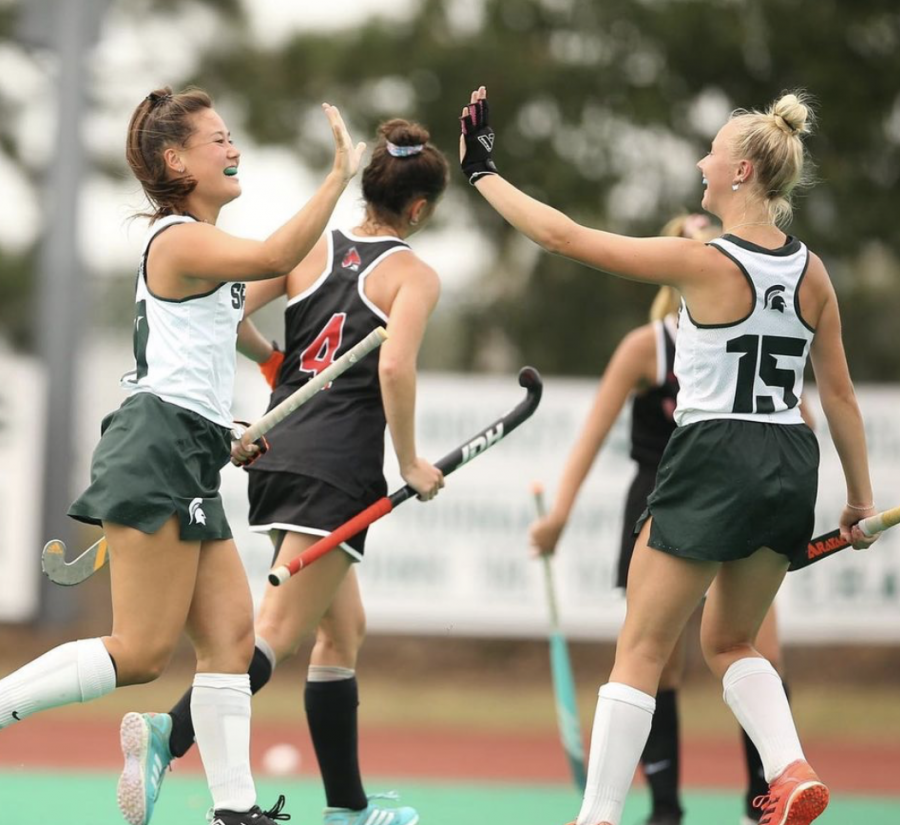 MSU midfielder Ellie Rutherford (15) high-fives Merel Hanssen in the Spartans 7-1 victory over Ball State on Sept. 12/ Photo Credit: MSU Athletic Communications