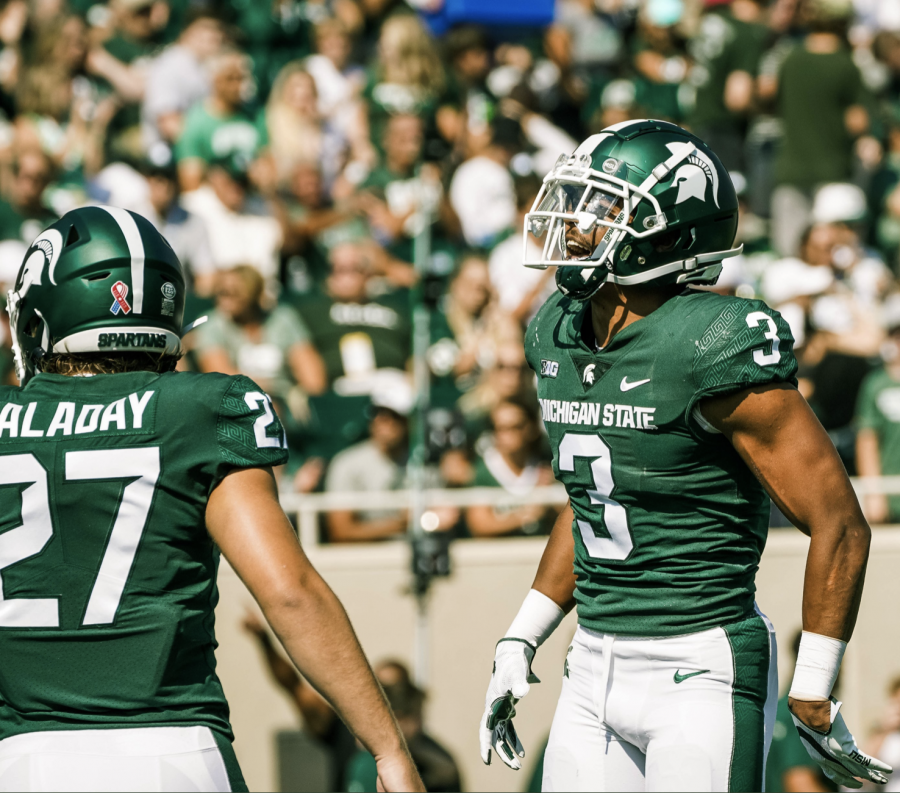 MSU linebacker Cal Haladay (27) and safety Xavier Henderson (3) smile in the Spartans 42-14 home win over Youngstown State on Sept. 18/ Photo Credit: MSU Athletic Communications