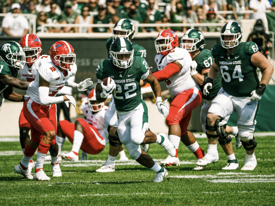 MSU running back Jordon Simmons hits the hole and runs for a big gain in the Spartans 42-14 home win over Youngstown State on Sept. 11/ Photo Credit: MSU Athletic Communications