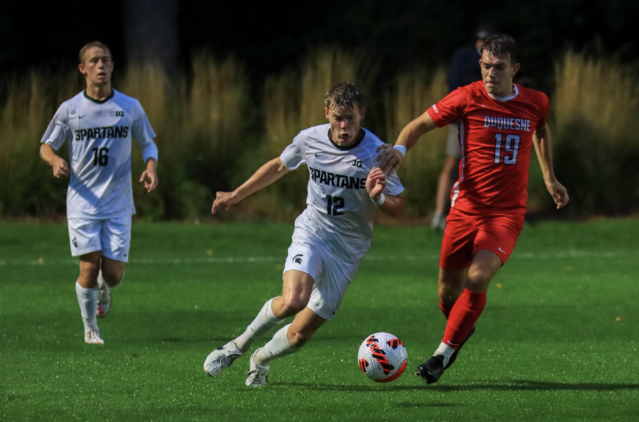 MSU defender Nick Stone attempts to keep the ball away from Duquesne forward Zack Mowka (19) in the Spartans 1-0 win on Sept. 21, 2021/ Photo Credit: Sarah Smith/WDBM