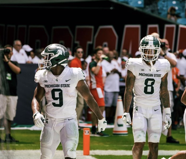 MSU+running+back+Kenneth+Walker+%289%29+accompanies+wide+receiver+Jalen+Nailor+%288%29+in+the+end+zone+during+the+Spartans+38-17+victory+over+No.+24+Miami+on+Sept.+18%2C+2021%2F+Photo+Credit%3A+MSU+Athletic+Communications+