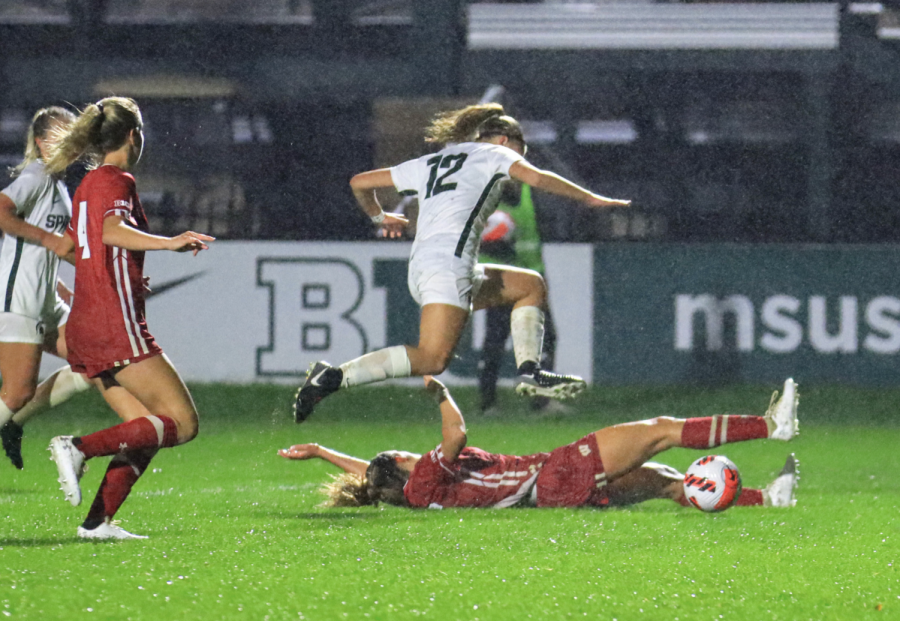 MSU+forward+Jordyn+Wickes+leaps+over+a+Wisconsin+defender+in+the+Spartans+1-0+loss+on+Sept.+23%2C+2021%2F+Photo+Credit%3A+Sarah+Smith%2FWDBM