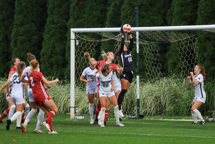 MSU+goaltender+Lauren+Kozal+makes+a+leaping+save+in+the+Spartans+1-0+loss+vs.+Wisconsin+on+Sept.+23%2C+2021%2F+Photo+Credit%3A+Sarah+Smith%2FWDM