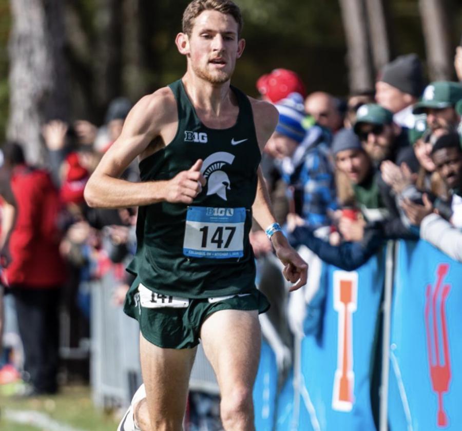 MSU distance runner Morgan Beadlescomb jogs during a race/ Photo Credit: MSU Athletic Communications