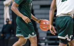 MSU point guard AJ Hoggard (11) looks for an open teammate as he is guarded by fellow point guard Tyson Walker (2)/ Photo Credit: MSU Athletic Communications