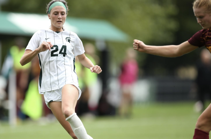 MSU forward/midfielder Ellie Rogers dribbles the ball during a game/ Photo Credit: MSU Athletic Communications